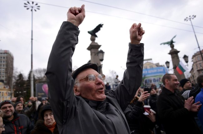 A man shouts slogans as people block the traffic during a protest against high electricity bills in Sofia